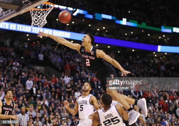 Zhaire Smith of the Texas Tech Red Raiders is unable to dunk the ball against Mikal Bridges of the Villanova Wildcats during the second half in the...