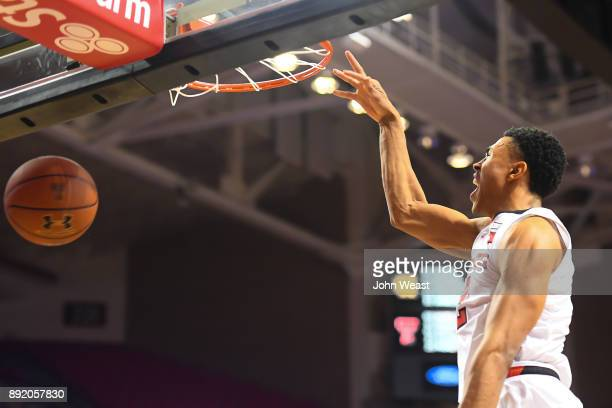 Zhaire Smith of the Texas Tech Red Raiders reacts while dunking the basketball during the game against the Kennesaw State Owls on December 13 2017 at...