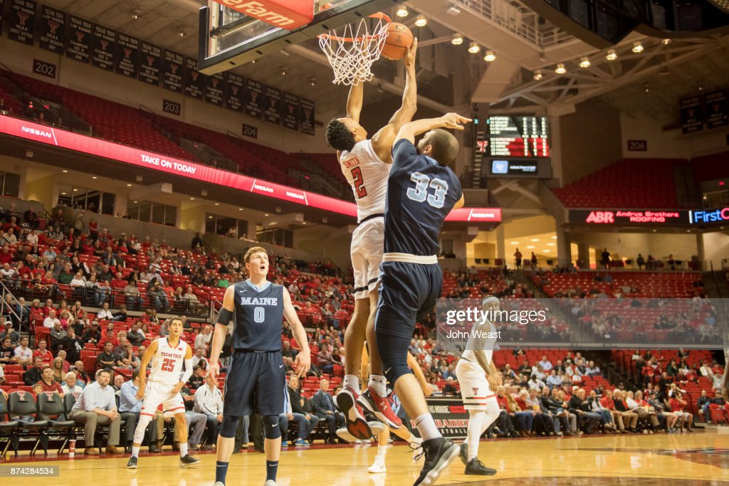Zhaire Smith #2 of the Texas Tech Red Raiders tries to dunk the basketball against the defense of Ilker Er #33 of the Maine Black Bears during the first half of the game on November 14, 2017 at United Supermarkets Arena in Lubbock, Texas.