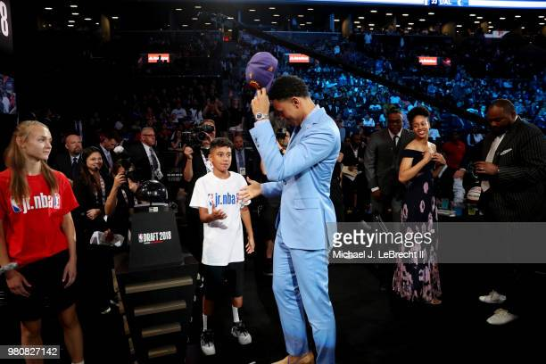 Zhaire Smith puts on the Phoenix Suns 2018 NBA Draft hat after being selected sixteenth overall by the Phoenix Suns on June 21 2018 at Barclays...