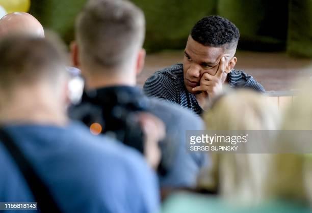 Zhan Beleniuk looks on as he attends a meeting with voters in Boyarka, near the Ukrainian capital of Kiev, on July 4, 2019. - Zhan Beleniuk, an...