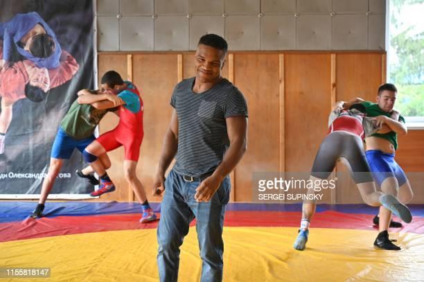 Zhan Beleniuk smiles as he leads a training of young wrestlers at a sports school for children in Boyarka, near the Ukrainian capital of Kiev, on...