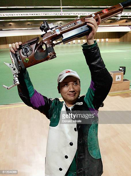 Zhanbo Jia of China celebrates winning the gold medal for the men's 50 metre rifle three position finals on August 22 2004 during the Athens 2004...