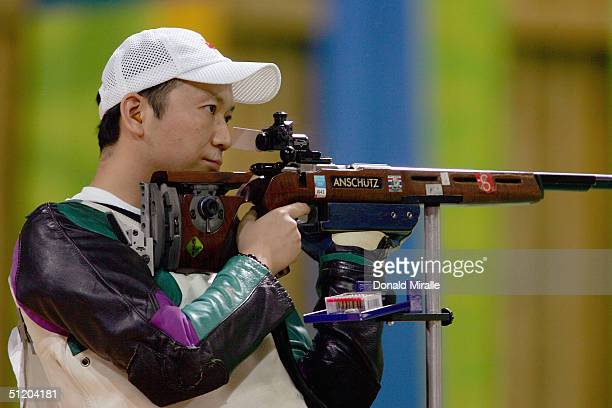 Zhanbo Jia of China competes in the men's 50 metre rifle three position finals on August 22 2004 during the Athens 2004 Summer Olympic Games at the...
