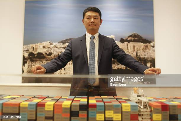 Zhang Anming deputy general manager of Piraeus Container Terminal SA poses for a photograph following a Bloomberg Television interview at the company...