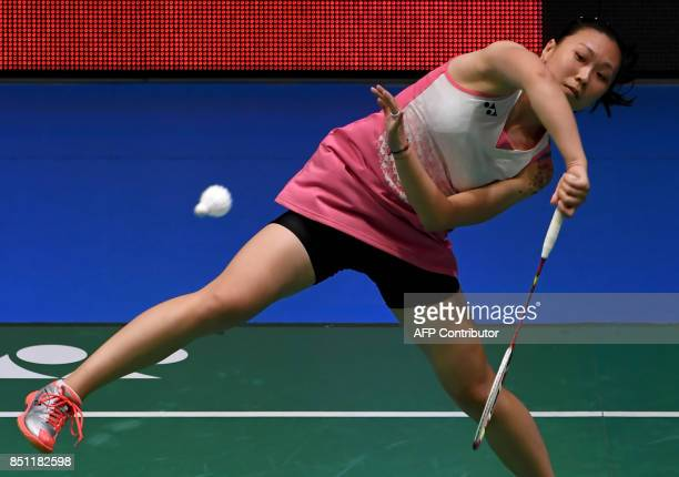 Zhang Beiwen of the US hits a return towards Nozomi Okuhara of Japan during their women's singles quarterfinal match at the Japan Open Badminton...