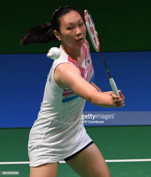 Zhang Beiwen of the US hits a return towards Sonia Cheah of Malaysia during their women's singles second round match at Japan Open Badminton...