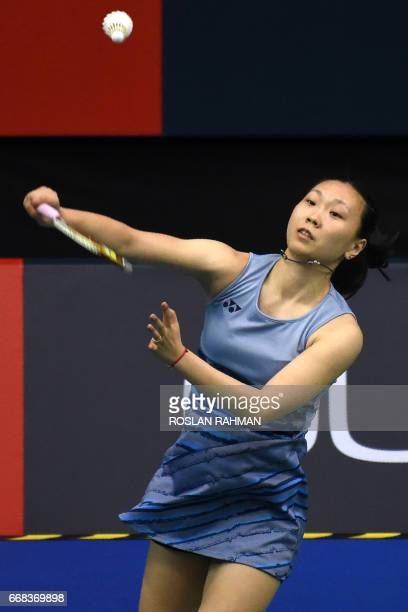 Zhang Beiwen of the US plays against Akane Yamaguchi of Japan during the women's singles quarterfinal of the Singapore Open badminton tournament in...