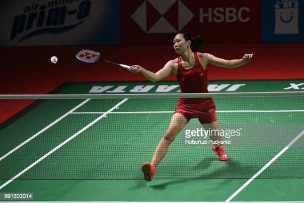 Zhang Beiwen of USA competes against Aya Ohori of Japan during the Women's Singles Round 1 match on day two of the Blibli Indonesia Open at Istora...