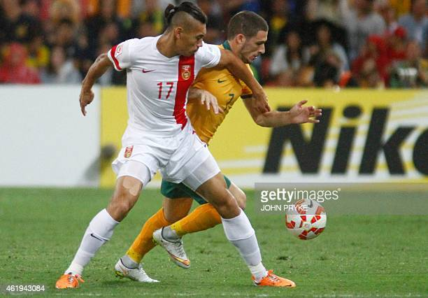 Zhang Chengdong of China fights for the ball with Mathew Leckie of Australia during the AFC Asian Cup quarterfinal football match between Australia...