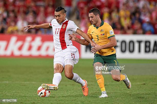 Zhang Chengdong of China PR competes for the ball with Mathew Leckie of Australia during the 2015 Asian Cup match between China PR and the Australian...
