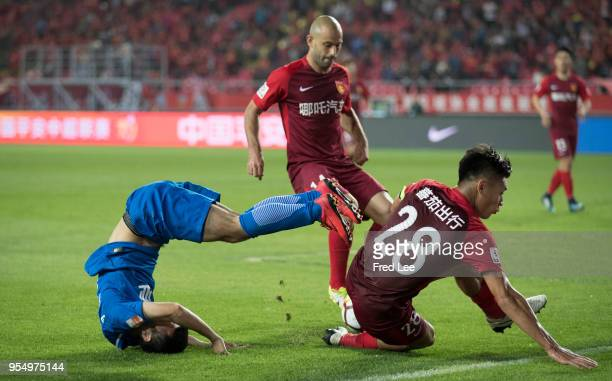 Zhang Chengdong of Hebei China Fortune and Wang Fei of Henan Jiany in action during 2018 Chinese Super League match between Hebei China Fortune adn...