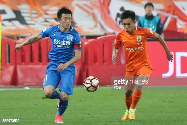 Zhang Chi of Shandong Luneng follows the ball during 2017 Chinese Football Association Super League 8th round match between Shandong Luneng Taishan...