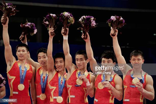 Zhang Chonglong, Teng Haibin, Zou Kai, Yan Mingyong, Feng Zhe and Chen Yibin of China stand on the podium pose together with their gold medals in...