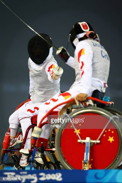 Zhang Chuncui and Zhang Wenxin of China compete in the quarterfinals of the Women's Individual Foil Category A at Fencing Hall of National Convention...