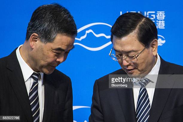 Zhang Dejiang chairman of the Standing Committee of the National People's Congress right and Leung Chunying Hong Kong's chief executive attend the...
