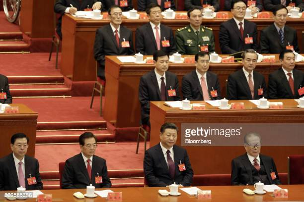 Zhang Dejiang, chairman of the Standing Committee of the National People's Congress, front row from left, Hu Jintao, China's former president, Xi...