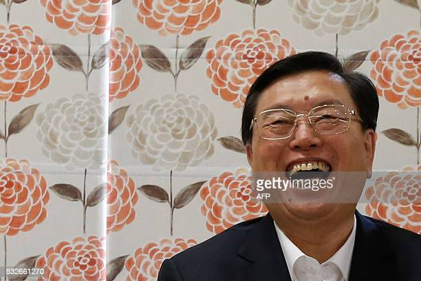 Zhang Dejiang the chairman of China's National People's Congress laughs during his visit to an aged care complex in Hong Kong on May 19 2016 Zhang...