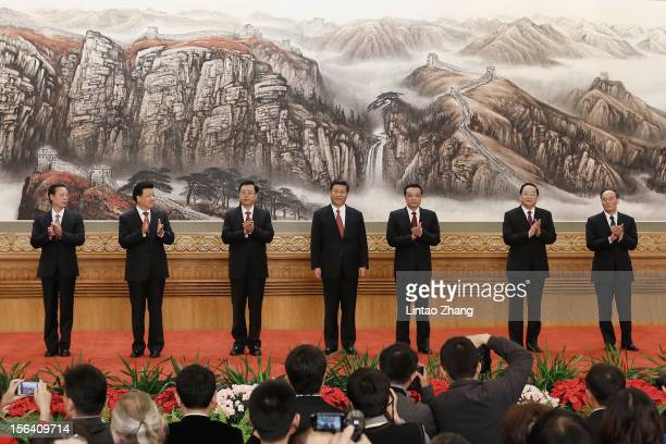 Zhang Gaoli Liu Yunshan Zhang Dejiang Xi Jinping Li Keqiang Yu Zhengsheng and Wang Qishan greet the media at the Great Hall of the People on November...