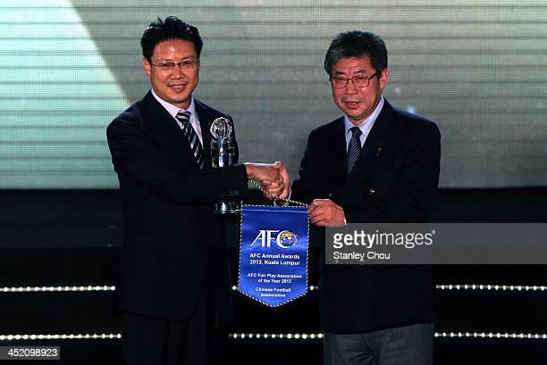 Zhang Jian General Secretary of Chinese Football Association receives the AFC Fair Play Association Award from AFC Vice President Zhang Jilong during...
