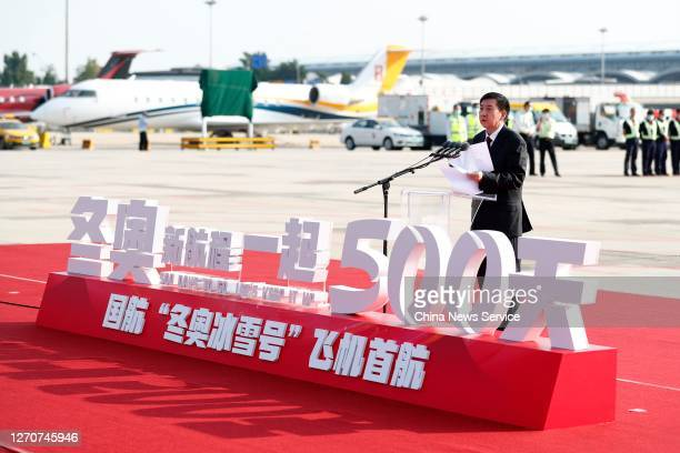 Zhang Jiandong vicemayor of Beijing and executive vicepresident of Beijing 2022 organizing committee speaks in front of a newly painted Boeing 737...