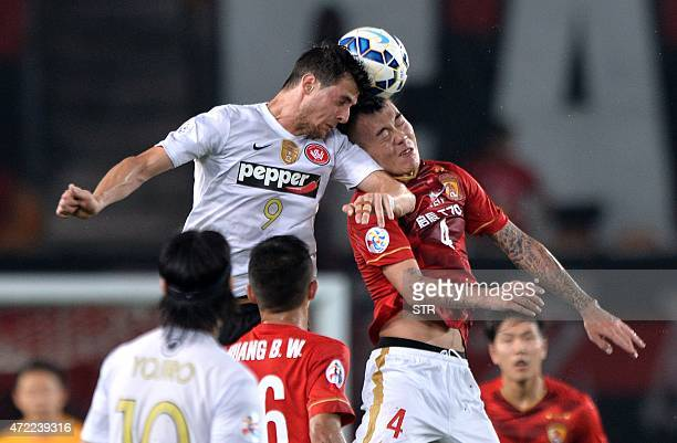 Zhang Jiaqi of China's Guangzhou Evergrande tussles for the ball against Tom Juric of Australia's Western Sydney Wanderers during their AFC Champions...