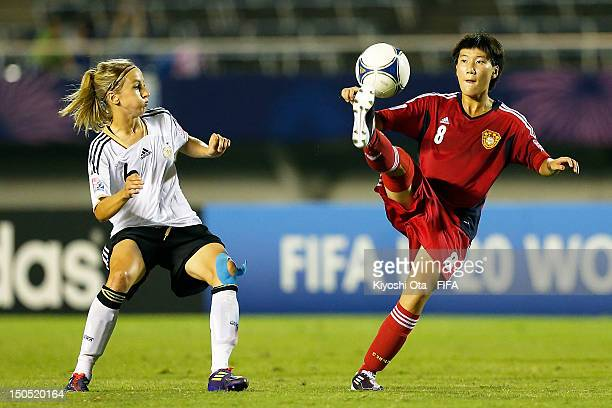 Zhang Jieli of China controls the ball against Kathrin Hendrich of Germany the FIFA U20 Women's World Cup Japan 2012 Group D match between Germany...
