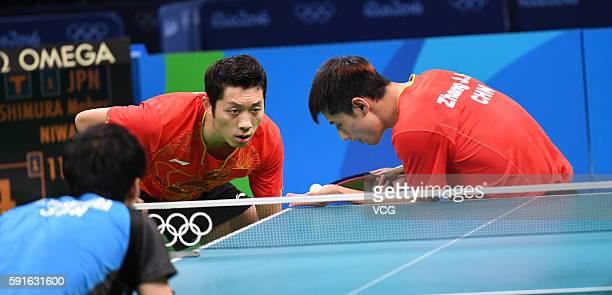 Zhang Jike and Xu Xin of China compete during the Men's Table Tennis gold medal match against Koki Niwa and Maharu Yoshimura of Japan at Riocentro -...