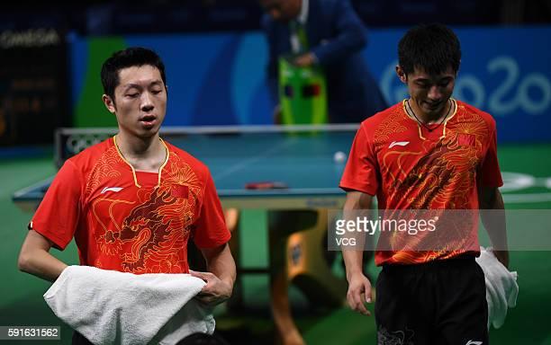 Zhang Jike and Xu Xin of China in action during the Men's Table Tennis gold medal match against Koki Niwa and Maharu Yoshimura of Japan at Riocentro...