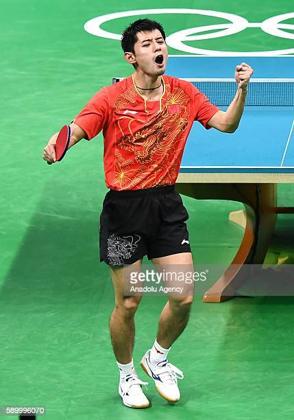Zhang Jike of China celebrates a point against Jeoung Youngsik of South Korea in the Mens Team Semifinal 1 on Day 10 of the 2016 Rio Olympics at...
