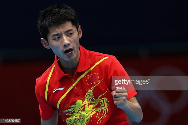 Zhang Jike of China celebrates during Men's Team Table Tennis first round match against team of Russia on Day 8 of the London 2012 Olympic Games at...