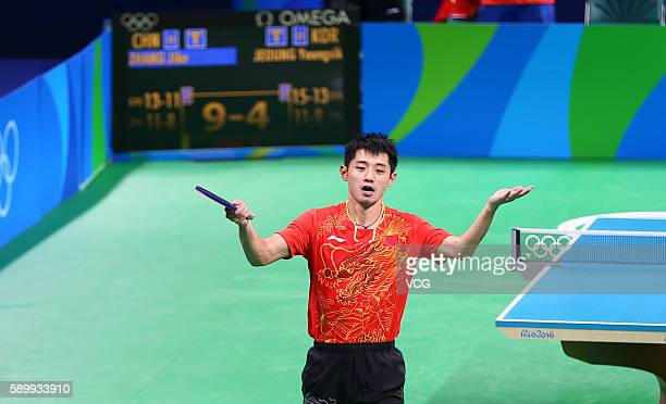 Zhang Jike of China celebrates in a match against Youngsik Jeoung of Korea during the Table Tennis Men's Team Semifinal on Day 10 of the Rio 2016...