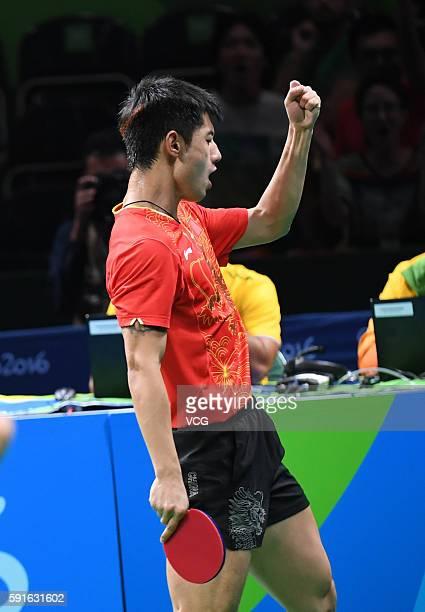 Zhang Jike of China celebrates with Xuxin of China during the Men's Table Tennis gold medal match against Koki Niwa and Maharu Yoshimura of Japan at...