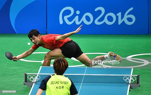 Zhang Jike of China competes against Jeoung Youngsik of South Korea in the Mens Team Semifinal 1 on Day 10 of the 2016 Rio Olympics at Riocentro -...