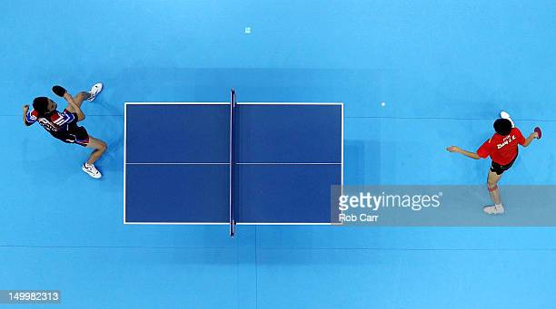 Zhang Jike of China competes against Saehyuk Joo of Korea during the Men's Team Table Tennis gold medal match on Day 12 of the London 2012 Olympic...