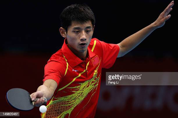 Zhang Jike of China competes during Men's Team Table Tennis first round match against team of Russia on Day 8 of the London 2012 Olympic Games at...