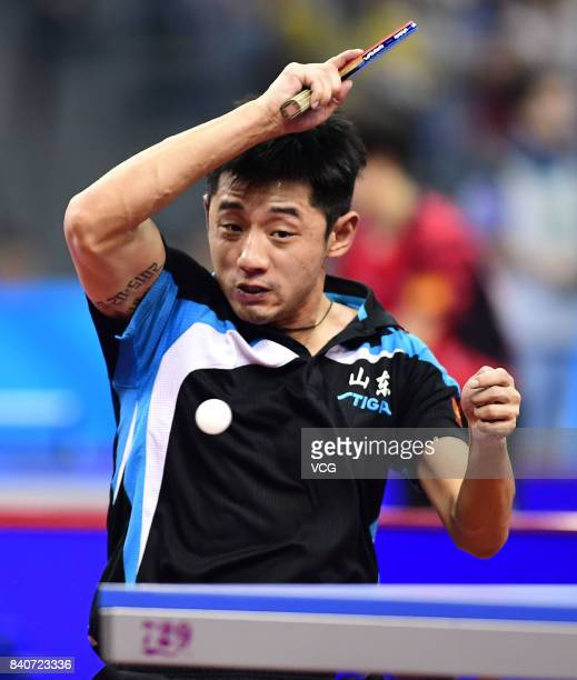 Zhang Jike of China competes in the Men's Team first stage third round matches of the 13th Chinese National Games at Wuqing sport center on August...