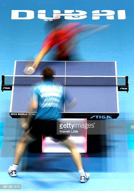 Zhang Jike of China in action against Robert Gardos of Austria during the Men's Final of the 2015 ITTF World Team Cup at Al Nasr Sports Stadium on...