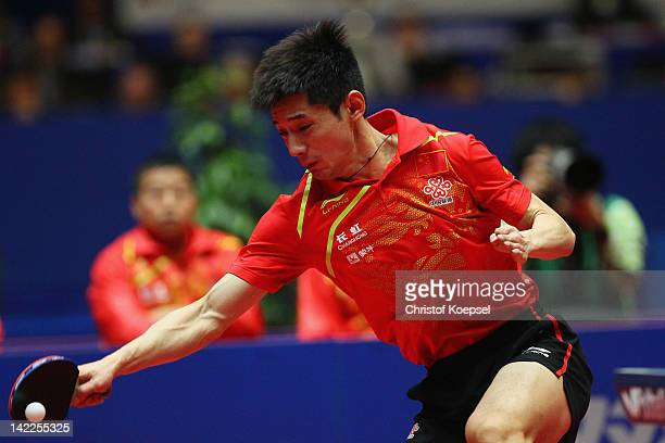 Zhang Jike of China plays a forehand during his match against Timo Boll of Germany during the LIEBHERR table tennis team world cup 2012 championship...