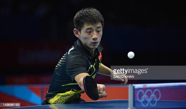 Zhang Jike of China plays a return during his table tennis men's gold medal singles match against compatriot Wang Hao for the London 2012 Olympic...