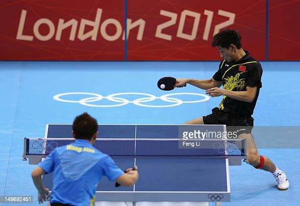 Zhang Jike of China plays a shot during Men's Singles Table Tennis Gold medal match against Wang Hao of China on Day 6 of the London 2012 Olympic...