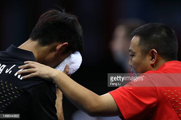 Zhang Jike of China talks with his coach Liu Guoliang during his Men's Singles Table Tennis fourth round match against Vladimir Samsonov of Belarus...