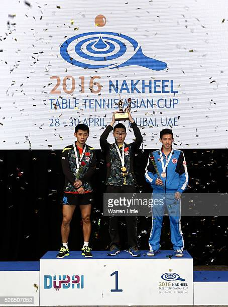 Zhang Jike of China, Xu Xin of China and Wong Chun Ting of Hong Kong pose on the podium after the Men's singles final of the Nakheel Table Tennis...