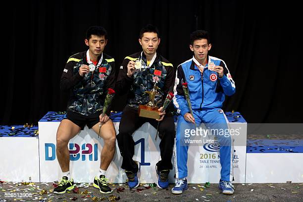 Zhang Jike of China Xu Xin of China and Wong Chun Ting of Hong Kong pose on the podium after the Men's singles final of the Nakheel Table Tennis...
