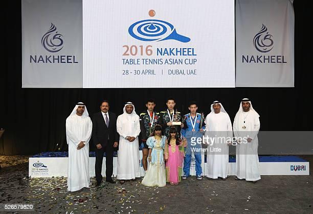 Zhang Jike of China Xu Xin of China and Wong Chun Ting of Hong Kong are awared their medals by Dawoud Al Hajri President of the UAE Badminton and...