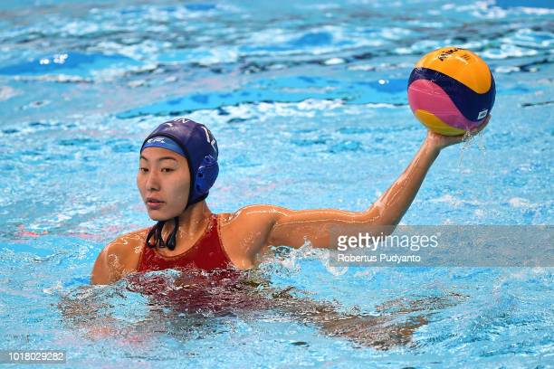 Zhang Jing of China throws during the Women's Water Polo Preliminary Round between Japan and China in the Asian Games 2018 at Aquatic Center Gelora...
