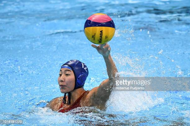 Zhang Jing of China throws the ball during the Women's Water Polo Preliminary Round match between Japan and China in the Asian Games 2018 at Aquatic...