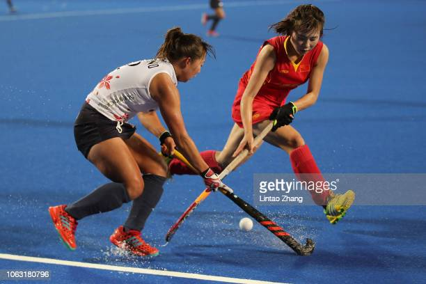 Zhang jinrong of China battles for the ball with Yukari Mano of Japan during the FIH Champions Trophy match between China and Japan on November 18...