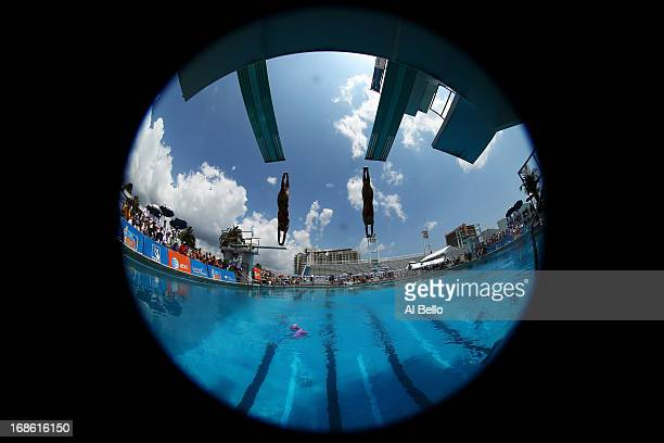 Zhang Jun and Qu Lin of China dive during the Women's 3 Meter Synchronized Springboard Finals at the Fort Lauderdale Aquatic Center on Day 4 of the...