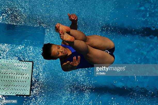 Zhang Jun of China dives during the Women's 3 Meter Springboard Finals at the Fort Lauderdale Aquatic Center on Day 3 of the ATT USA Diving Grand...